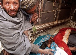 An Afghan man cries over the bodies of some of the victims of the shootings by a US soldier 