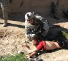 jeremy_morlock_pulling_dead_afghan_boy_by_his_hair_in_20101